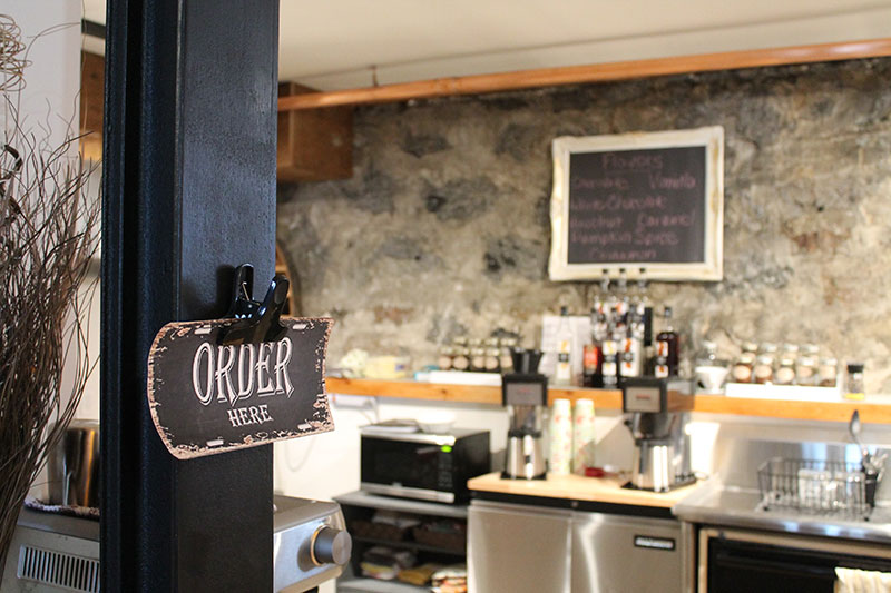 Picture of new coffee shop with Order Here sign