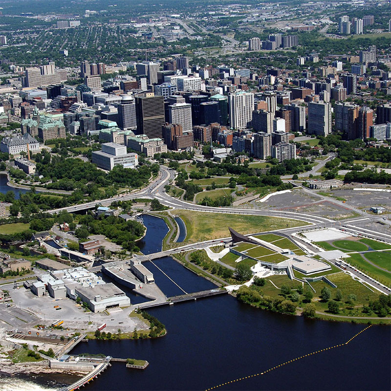 An aerial image of downtown Ottawa showing buildings and canal