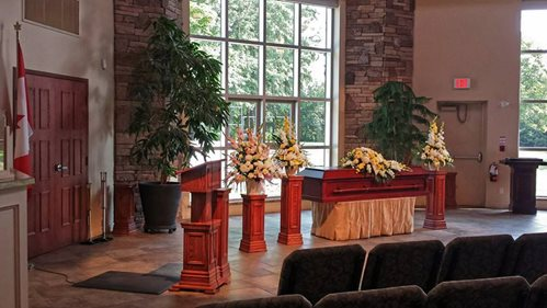 A church pulpit with a wreathed casket